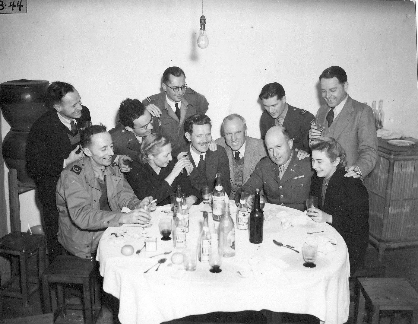 Max (standing on right), WL Bond of CNAC (fifth from right) and unidentified friends in prewar Hong Kong