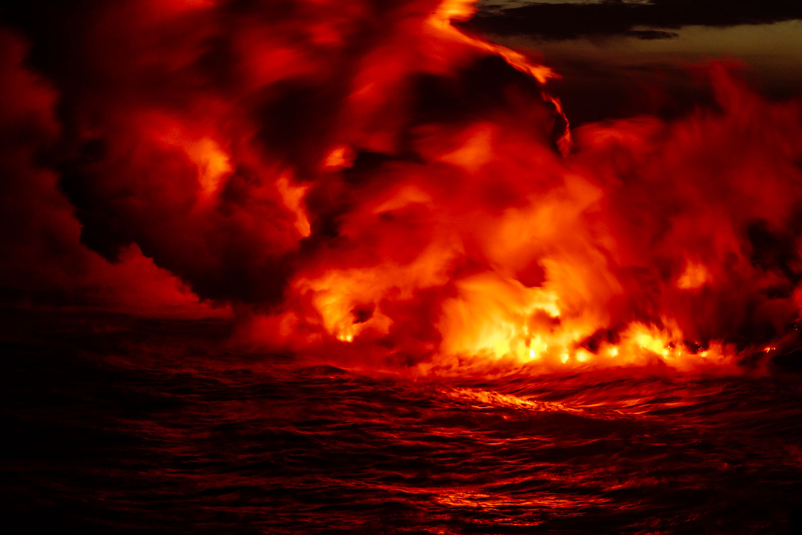 LAVA ENTERS THE OCEAN AT VOLCANOES NATIONAL PARK IN HAWAI'I