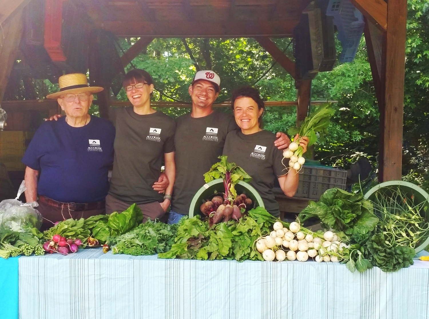 Staff and volunteers at the first market of the season.jpg