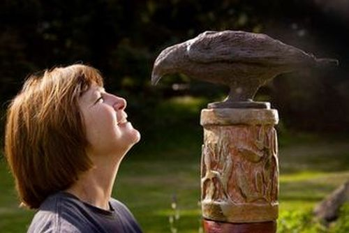 Landowner Sally with a sculpture she created.