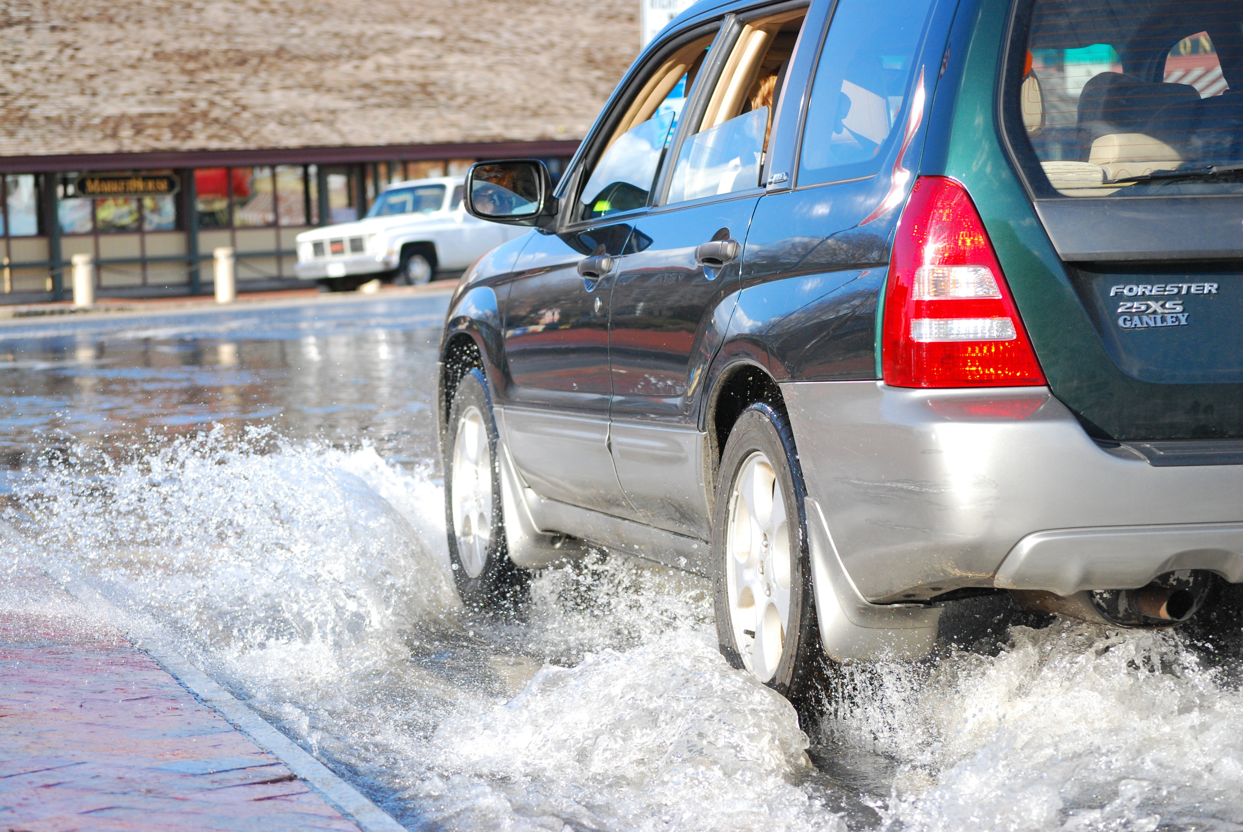A car drives through flood waters on Main Street in Annapolis, Maryland. Photo by the  Chesapeake Bay Program .