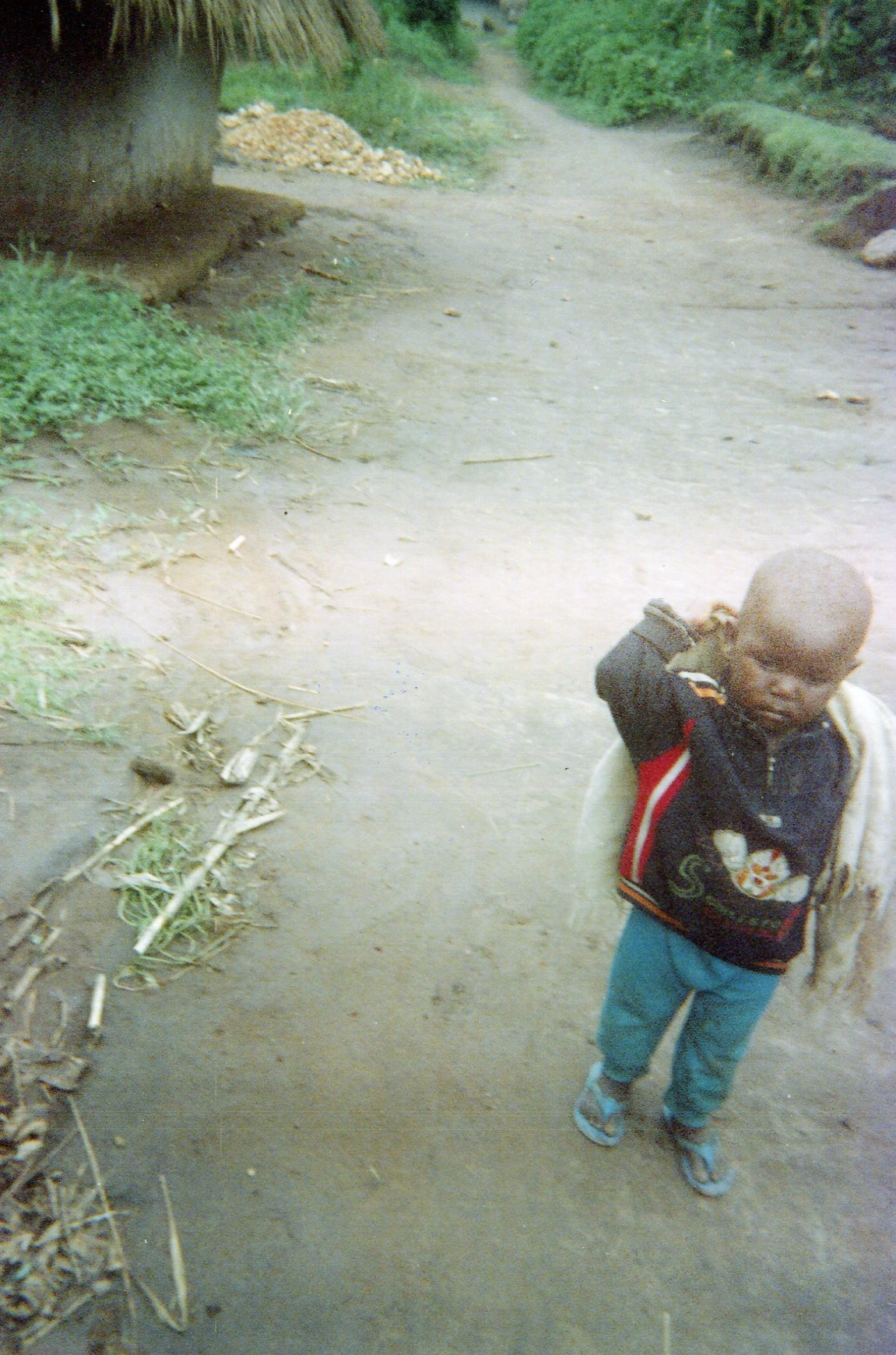 This child is forgotten and abandoned in the village following the war.