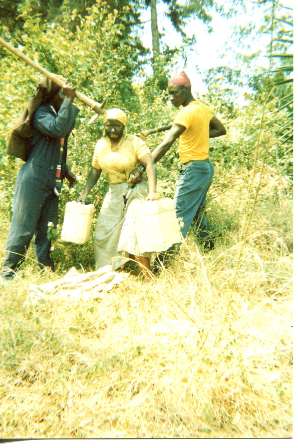 I am in the bush being escorted to fetch water.