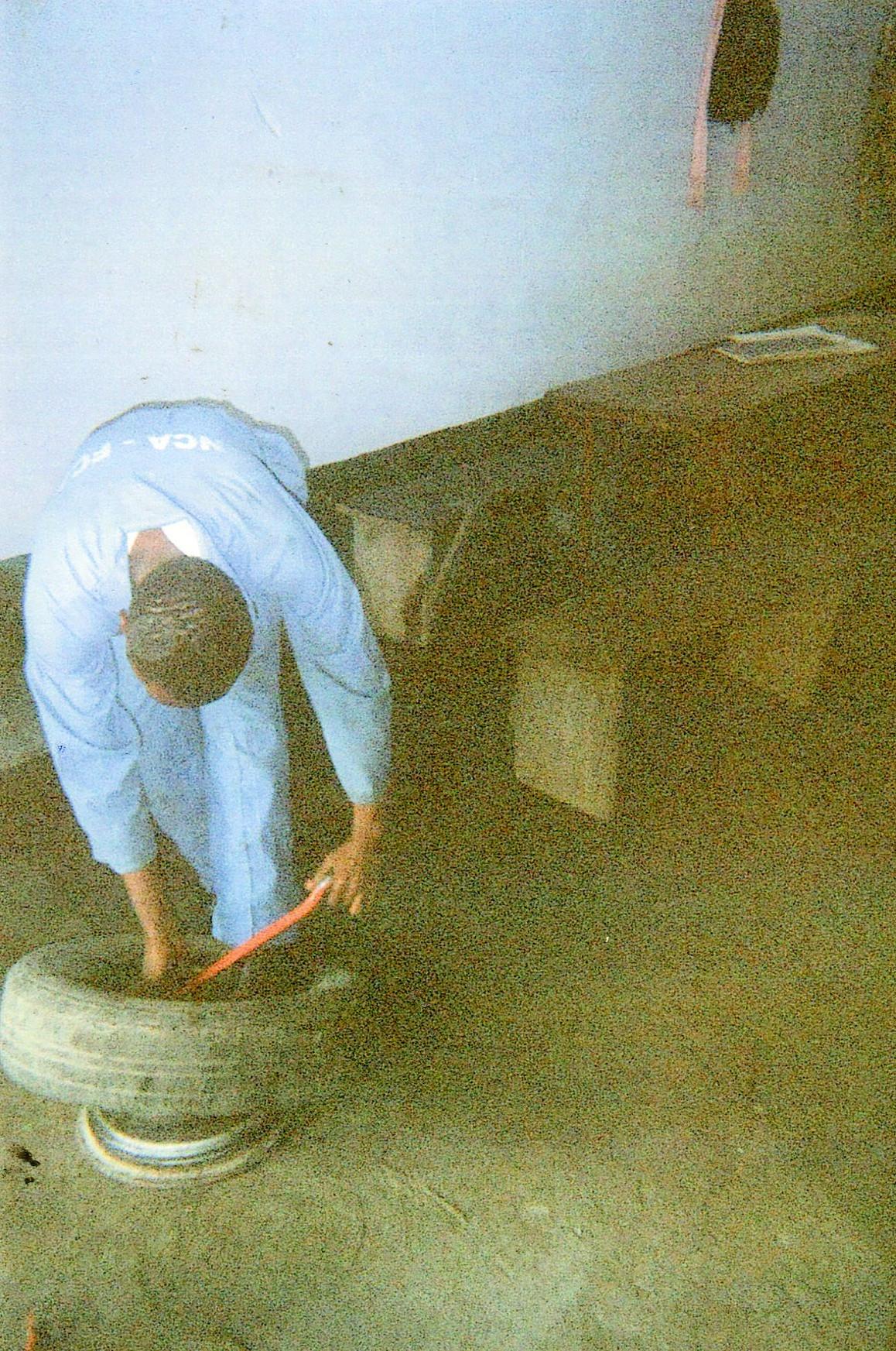 I am repairing a car tire.