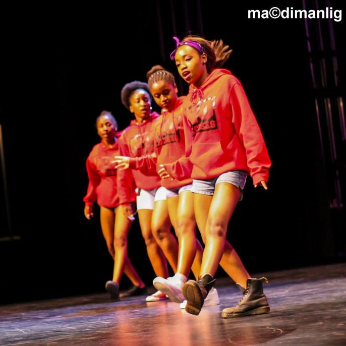 Nataly, far right, performing. Photo by  Mac Dimanlig .