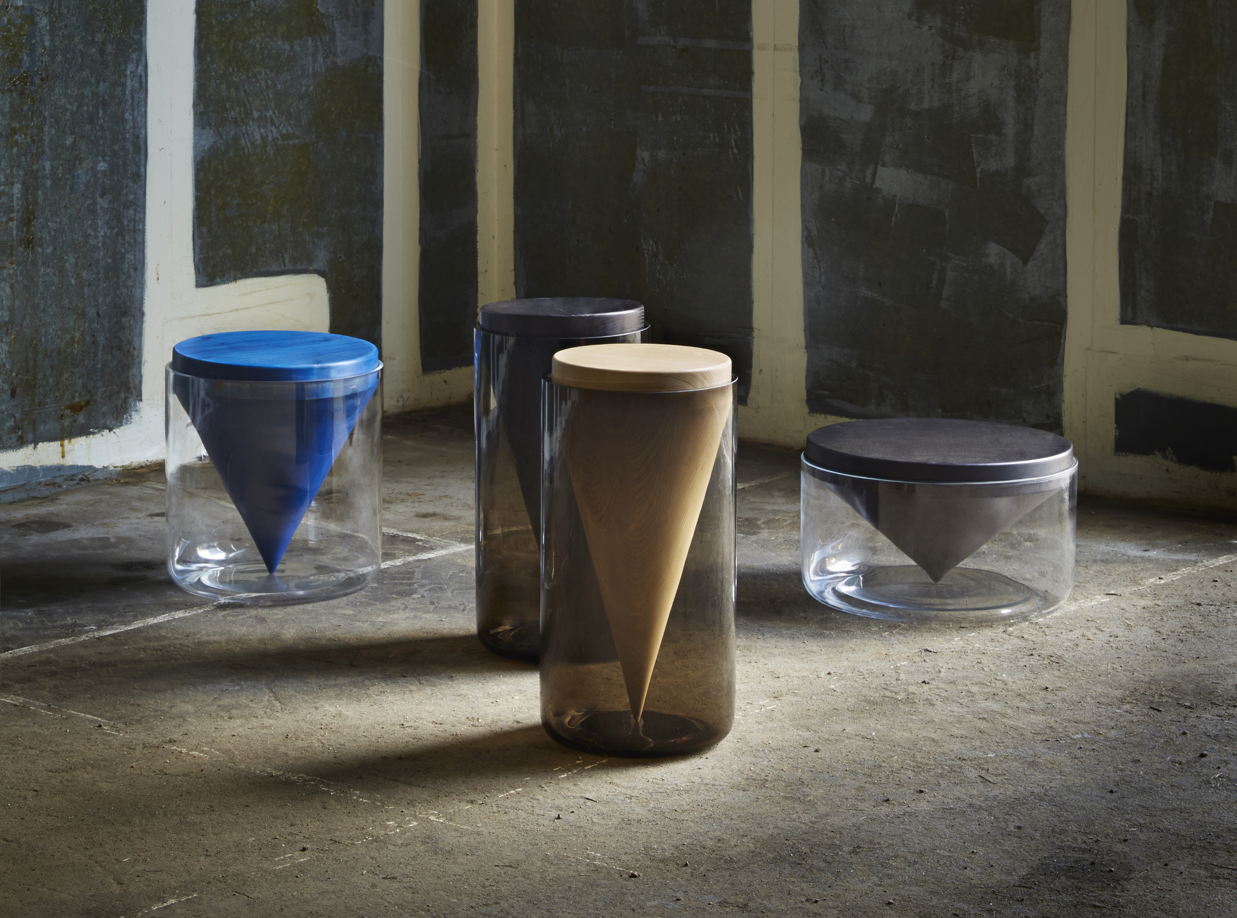 In a reverse from the norm, handblown glass vessels encase and support turned wooden cones in Hunting & Narud's Apex Tables. With minimal contact between the two materials, the apex of the cone which is a small 5mm point, is the only part of the wood in direct contact with the glass creating a sharp visual contrast whilst encapsulating and highlighting the beauty of the wooden cones.  (Photo: Petr Krecji )