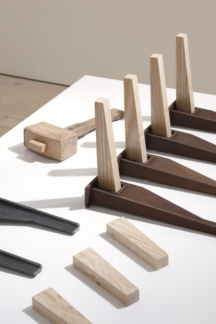 """Michael Marriott on Keel Series Bench """"By focusing on one of the most ancient engineering principles known to man, Narud has generated a series of forms that all feed off the nature of wedging. The finished objects hold some of that direct basic force found in machinery and equipment made during the industrial revolution, and with a similarly utilitarian vernacular."""""""