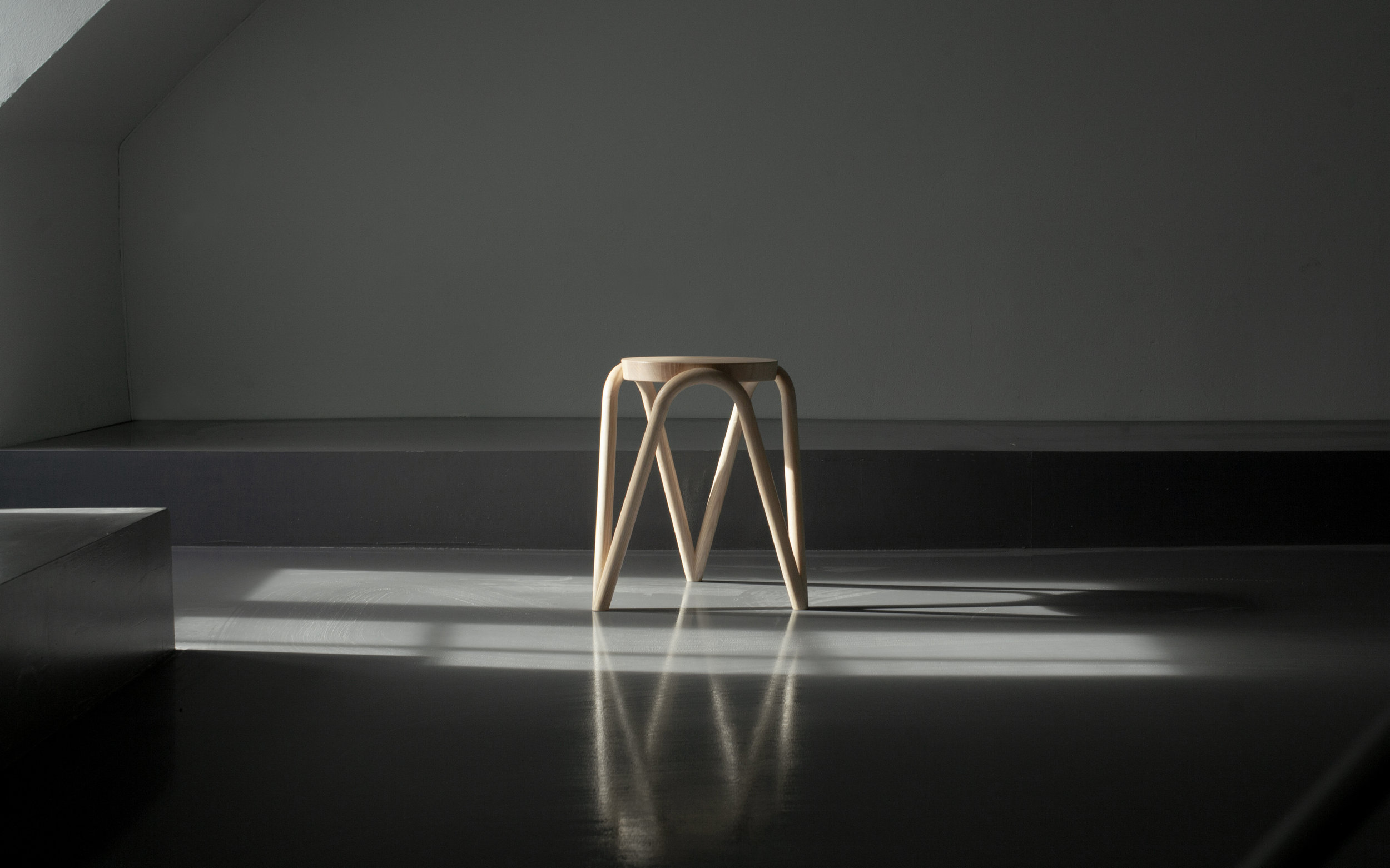 UN #101/256 The Vava Tabouret by Kristine Five Melvær  A stackable stool that combines classical elements in a new way. The name is inspired by the legs which moves up and down around the stool in a steady rhythm, giving the furniture its recognizable character.