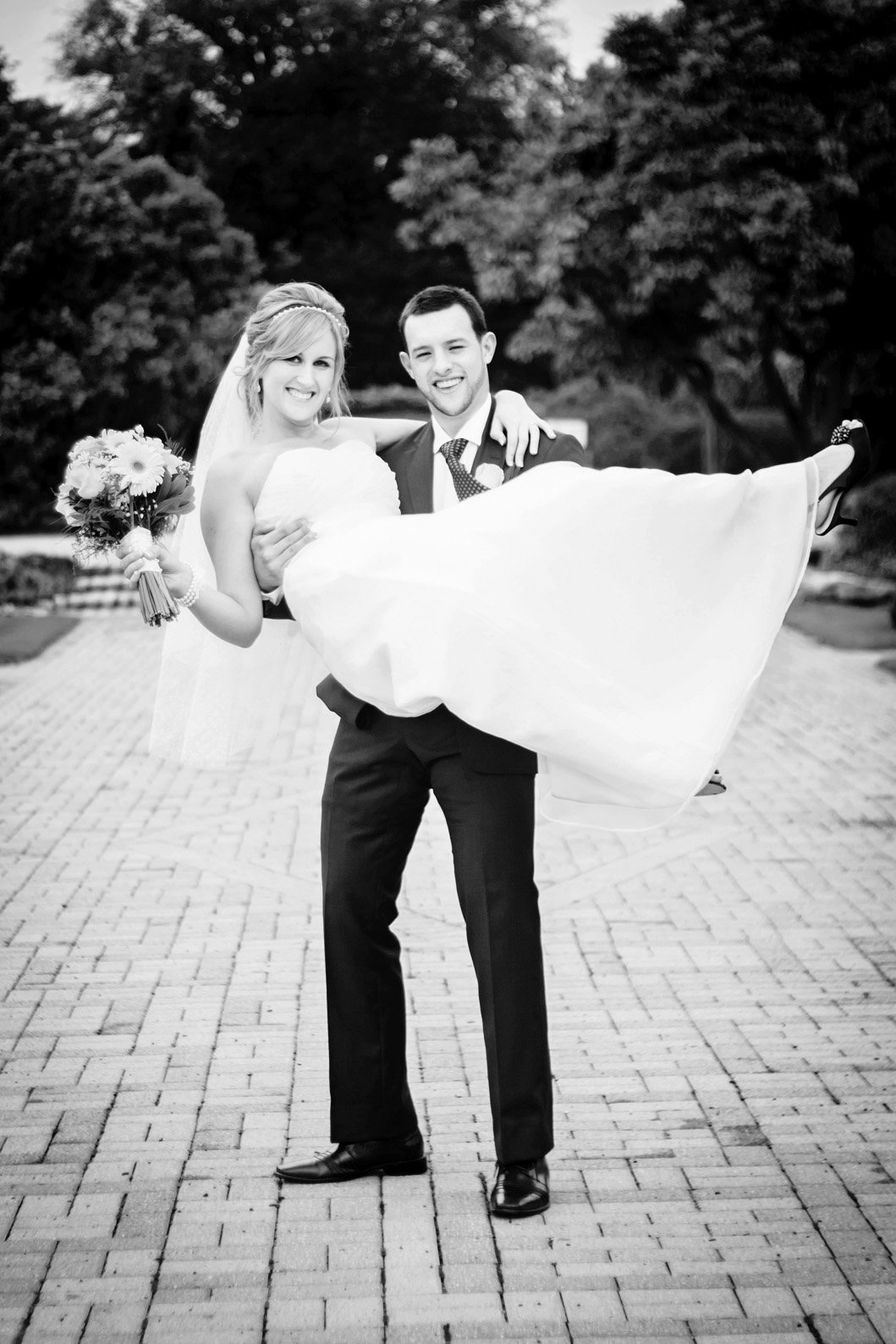"""HANNAH & JON CROLEY     Wedding Client    """"Nicki was so much more than a wedding photographer to me on my big day; she was a friend, an advisor, a therapist, wedding planner, stylist and on. She did a fabulous job, and my husband and I were so happy to have her share with us on our special day!"""""""