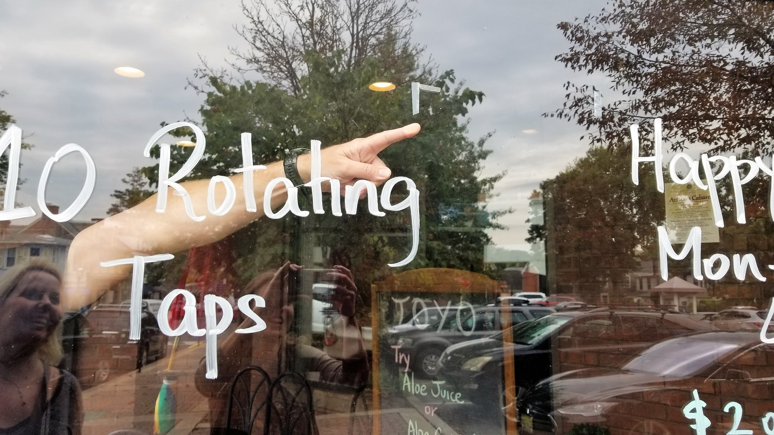 Real life example of scotch tape and handwritten words on a Doylestown storefront.