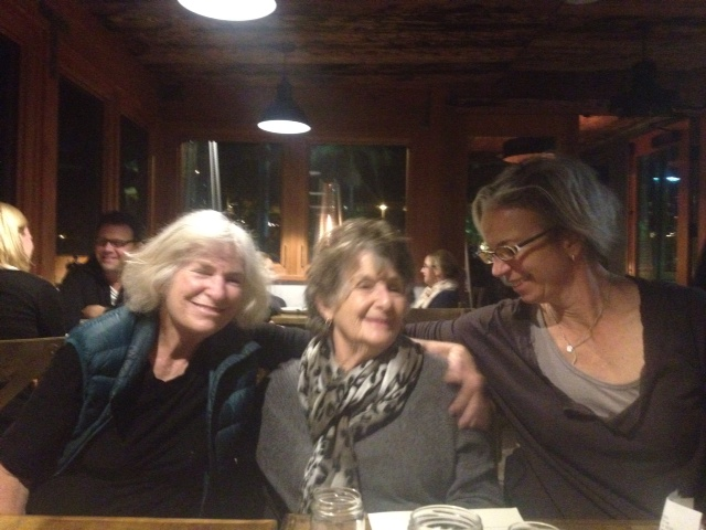 Marcia Burtt, Natalie Wilson and Rebecca August relax after a day of intense painting.