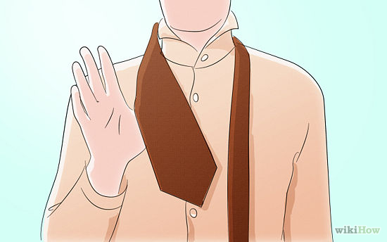 1   Stand in front of the  mirror  . Your collar should be up, your shirt buttoned all the way to the top, and the tie around your neck. The wide end of the tie should be on the side of your  dominant hand . So if you're right-handed, the wider end should be hanging on your right side. If you're left-handed,the wider end should be hanging on your left side.
