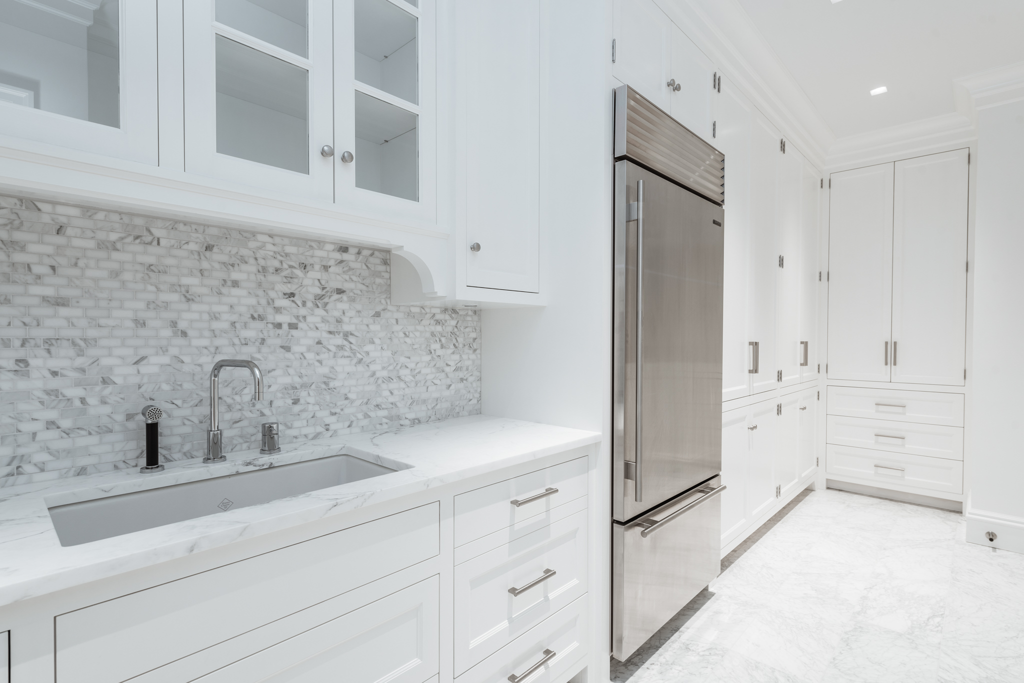 PANTRY:  After gutting some small, unused storage and pantry closets we were able to open up this walk-in Pantry off the kitchen which incorporates a wet-bar along with storage cabinetry.