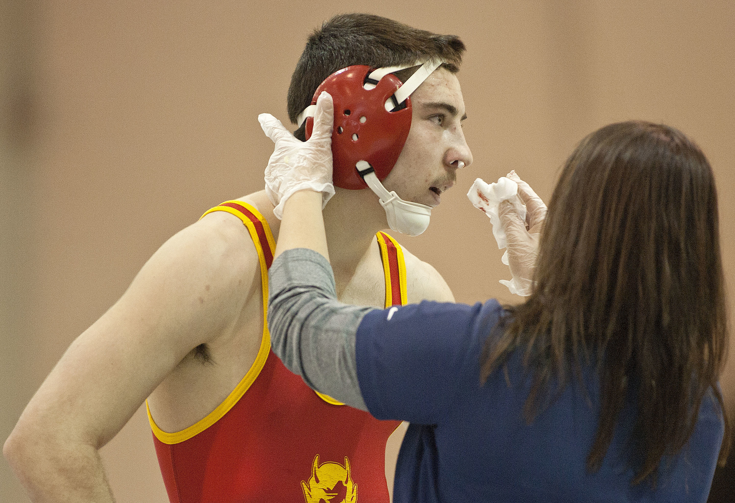 Murphysboro High School's Dylan Chambers is medically attended to during a first round match in the 132-pound tournament.