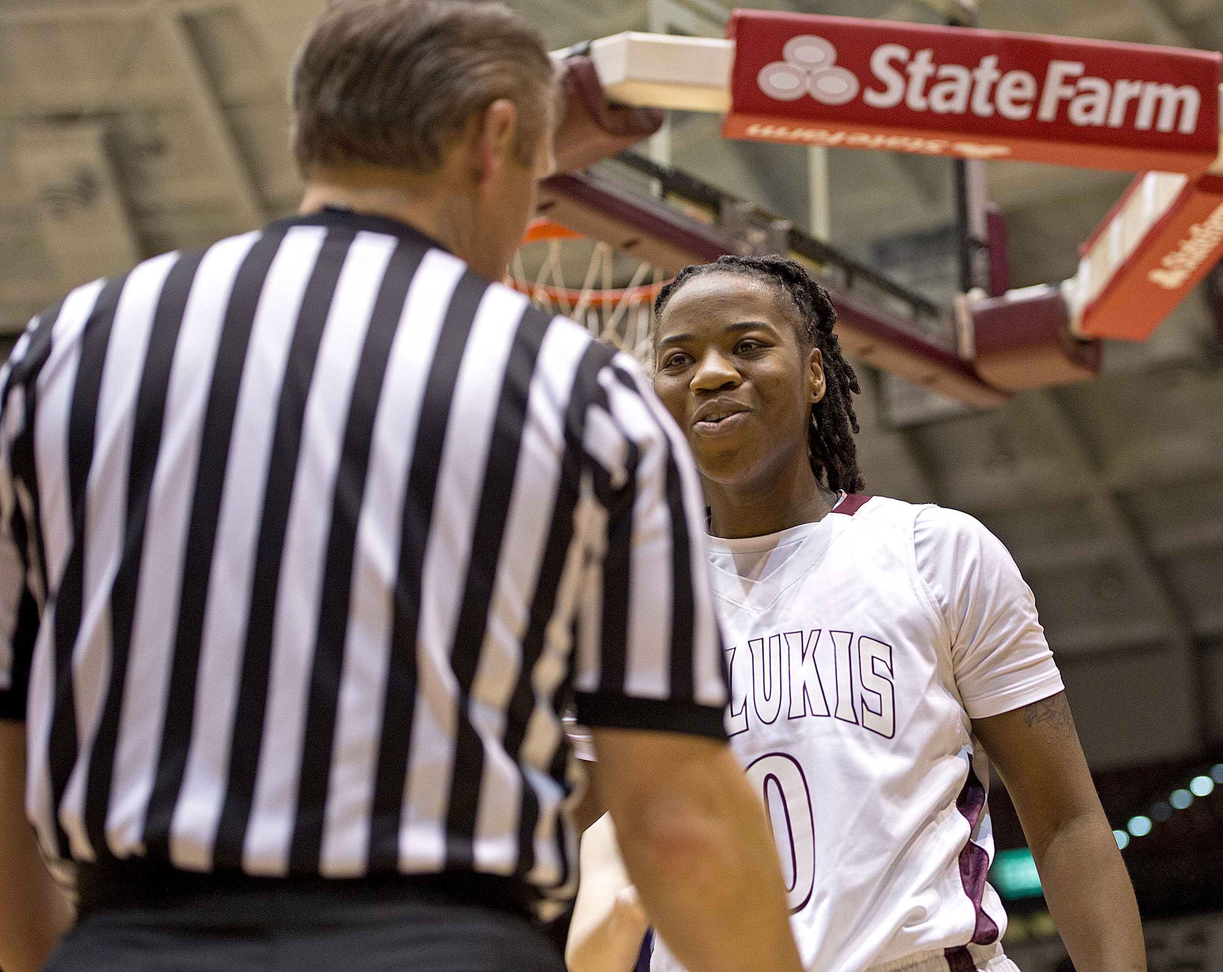 Salukis forward Dyana Pierre disputes a call with the official.