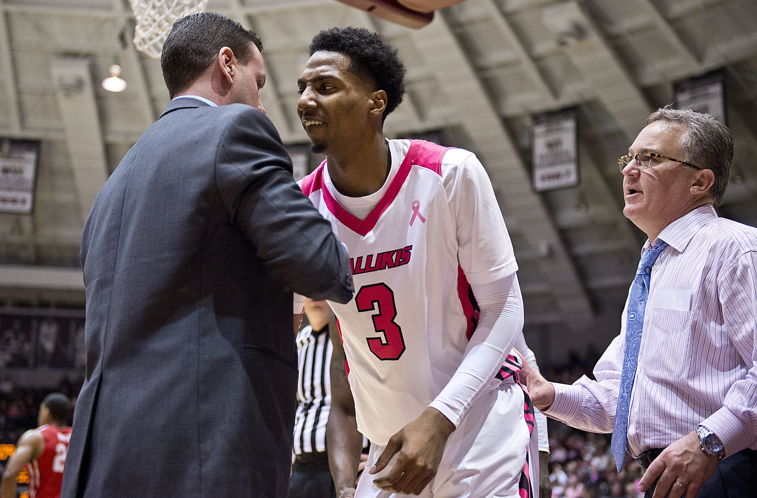 Salukis guard Desmar Jackson is helped up after getting fouled.