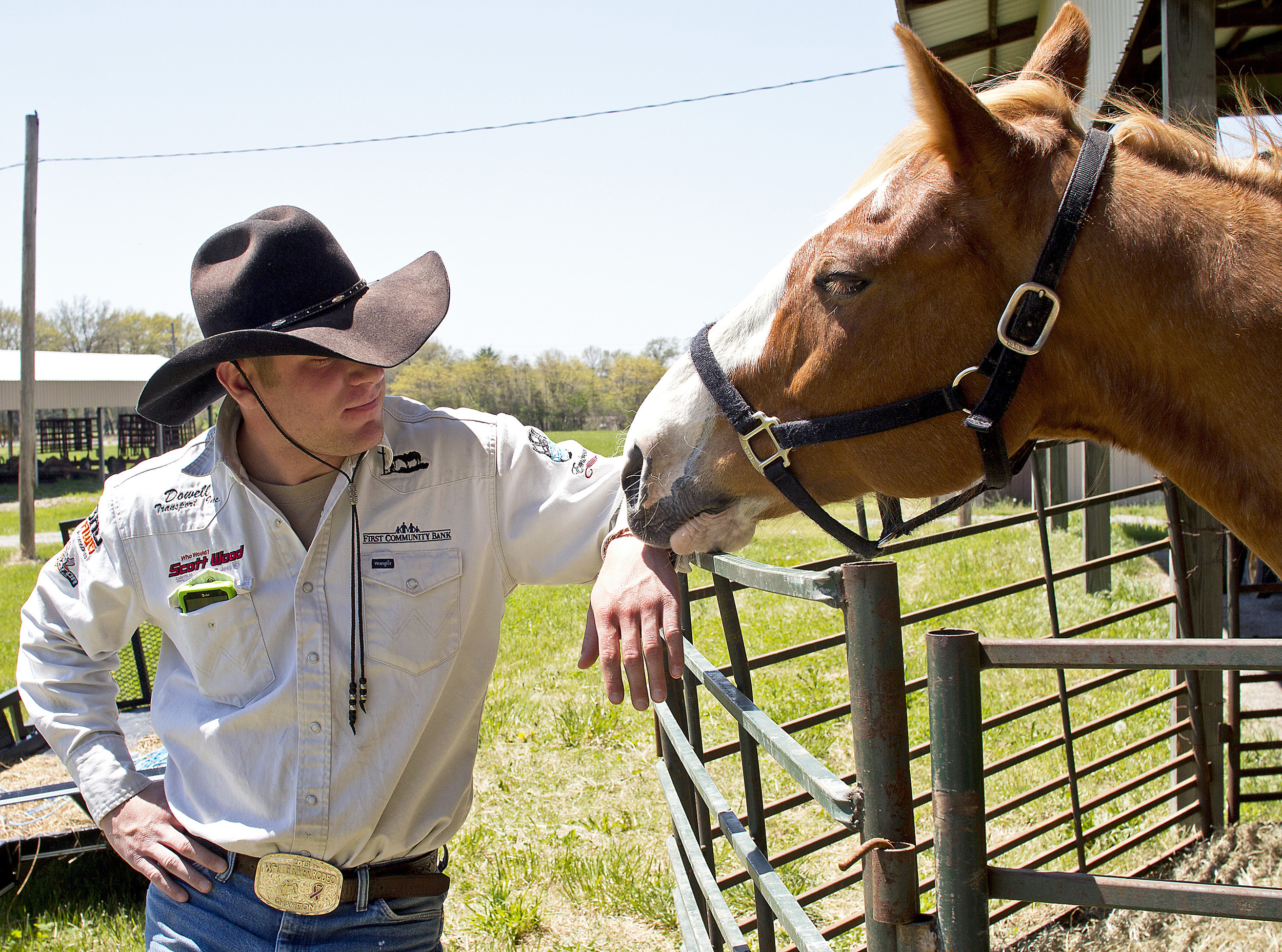 Tye Sturgeon, of Batesville, Ark., spends time with his horse Edward on April25at the Randolph County Fairgrounds in Sparta, Ill. Sturgeon hopes to ride across 48 states with Edward to benefit Western Wishes, a non-profit organization that helps children and young adults who are victims of severe spinal cord and head injuries as well as survivors of cancer.