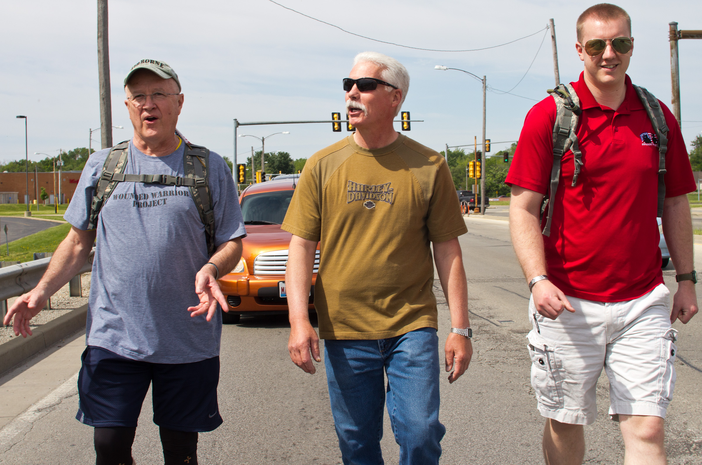 From left to right, Ron Stephens, Scott Hartman and Cody Floyd, all veterans, converse as they begin their journey towards Elwood, Ill., on May 24 in Decatur, Ill.