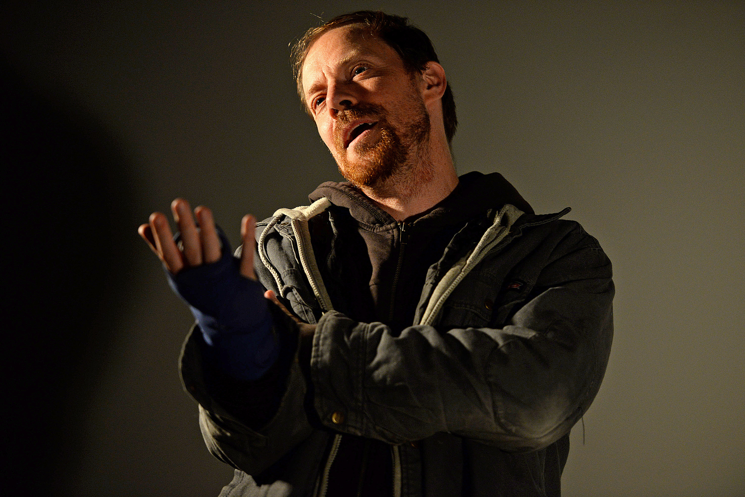 """Michael Milligan, of New York, acts out a scene from his one-man play """"Mercy Killers"""" on Sept. 22 at Guyon Auditorium in Morris Library."""
