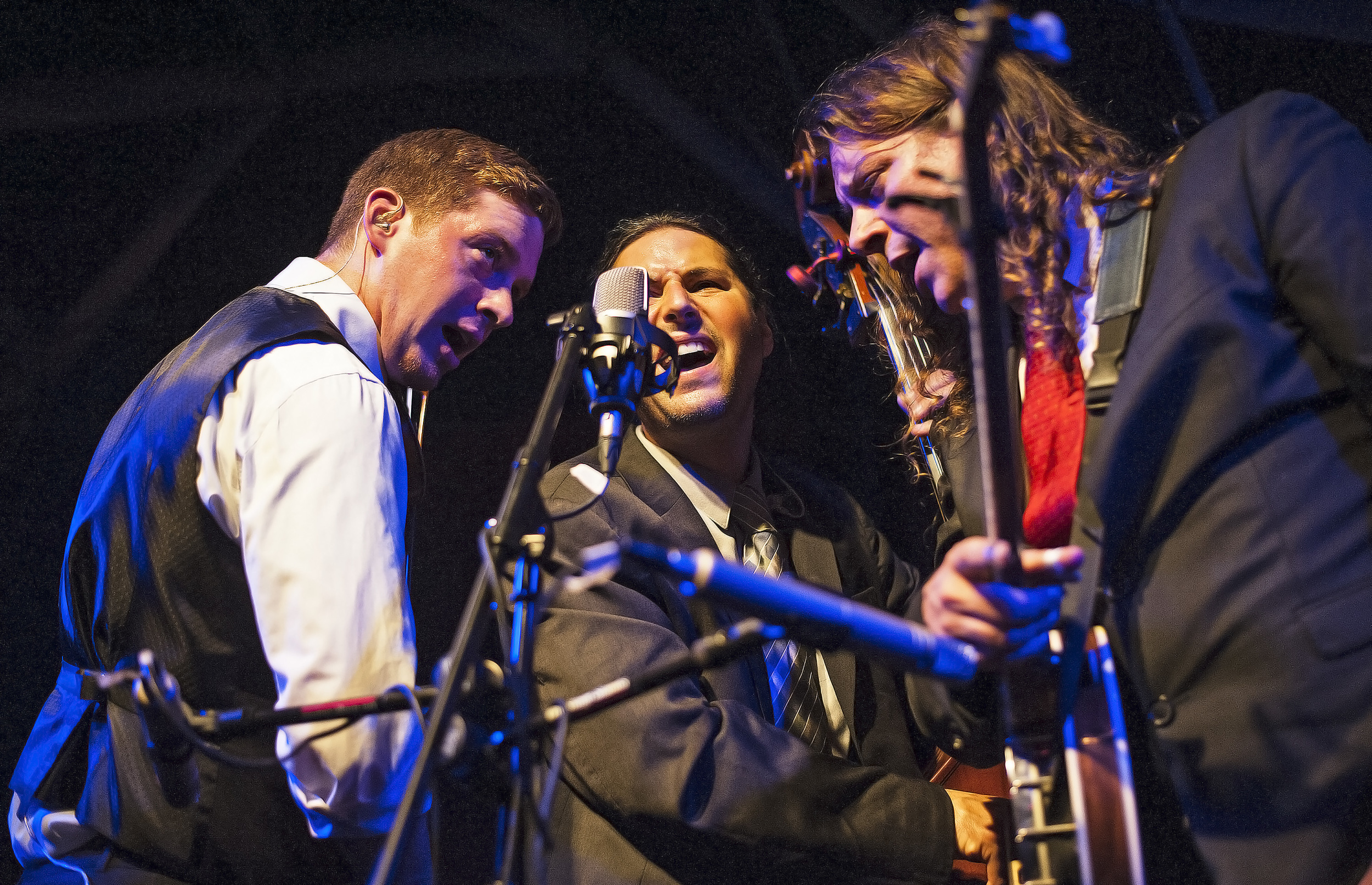 Dan Andree, left, Jon Goldfine, center, and Ben Wright, of Henhouse Prowlers, perform at Hangar 9 on Sept. 27. The band, of Chicago, has been playing bluegrass music for more than 10 years.