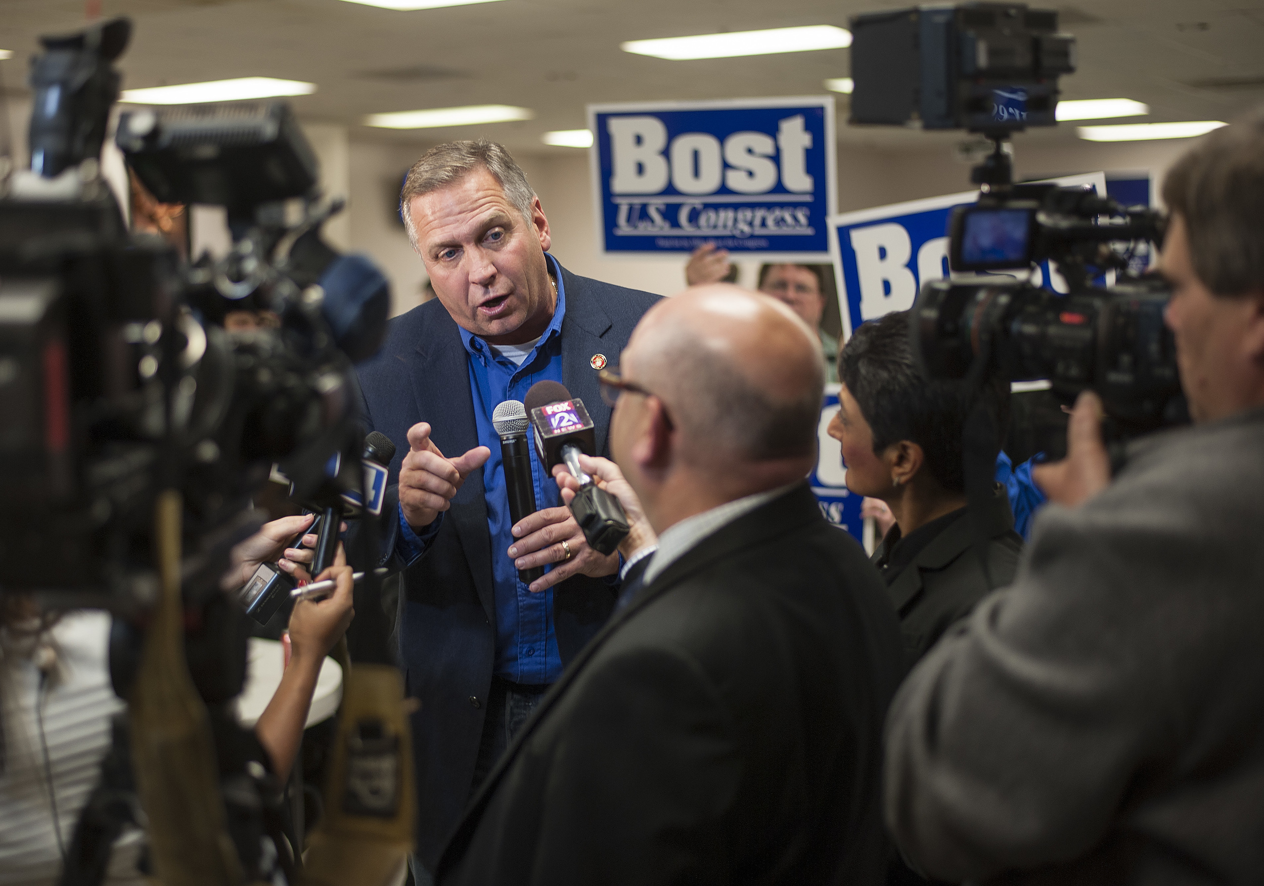Mike Bost  (R-Murphysboro) answers questions from local media after delivering his victory speech.