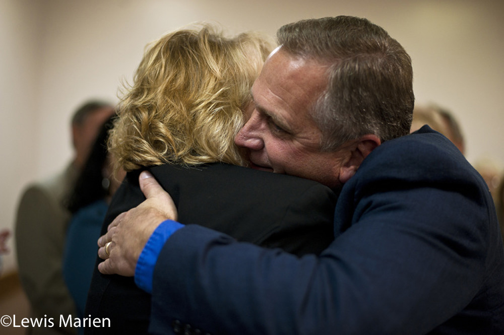 Mike Bost, R-Murphysboro, embraces Terri Bryant, R-Murphysboro, after both won their respective races on Nov. 4 (Election Day 2014) at the Elks Lodge in Murphysboro, Ill.