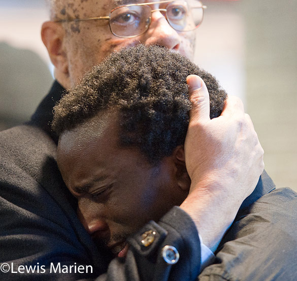 """The Rev. Joseph Brown, a SIU Carbondale professor of Africana Studies, consoles student Ben Smith during a """"die-in"""" demonstration on Dec. 9at the Student Center."""