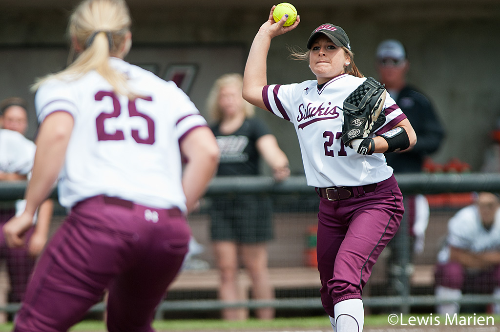 Southern Illinois' Katie Bertelsen (27) fields a ground ball to Shaye Harre (25) for an out during Game 1 of a doubleheader against Drake Universityat Charlotte West Stadium. Drake beat SIU 3-2.