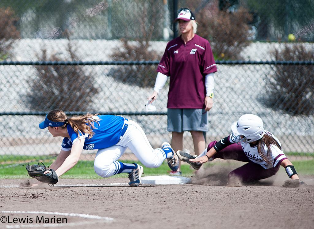 Southern Illinois' Kelsey Gonzalez slides into third during Game 1 of a doubleheader against Drake University  at Charlotte West Stadium. Drake beat SIU 3-2.