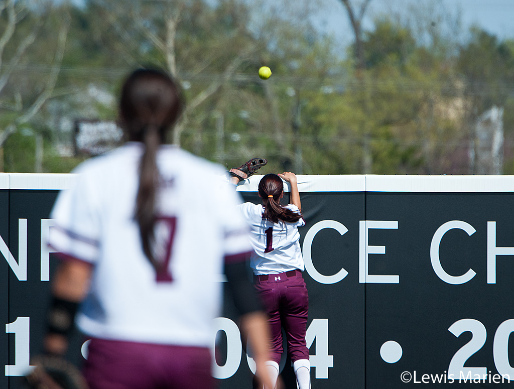 Southern Illinois' Merri Anne Patterson (1) and Kelsey Gonzalez (7) can only watch the ball go over the outfield wall for a Drake University home run during Game 2 of a doubleheader against Drake University  at Charlotte West Stadium. Drake beat SIU 4-1.
