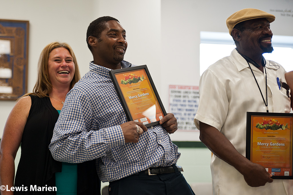 Milton Barbee, center, of Decatur, Ill., jokes around while being recognized during the Mercy Gardens' graduation of its first class on Jul. 10 at the Good Samaritan Inn in Decatur, Ill. Mercy Gardens, a horticulutral job skill training program, is a partnership with the Good Samaritan Inn and Decatur Is Growing Gardeners (DIGG), and helps individuals change their lives around to learn new skills.