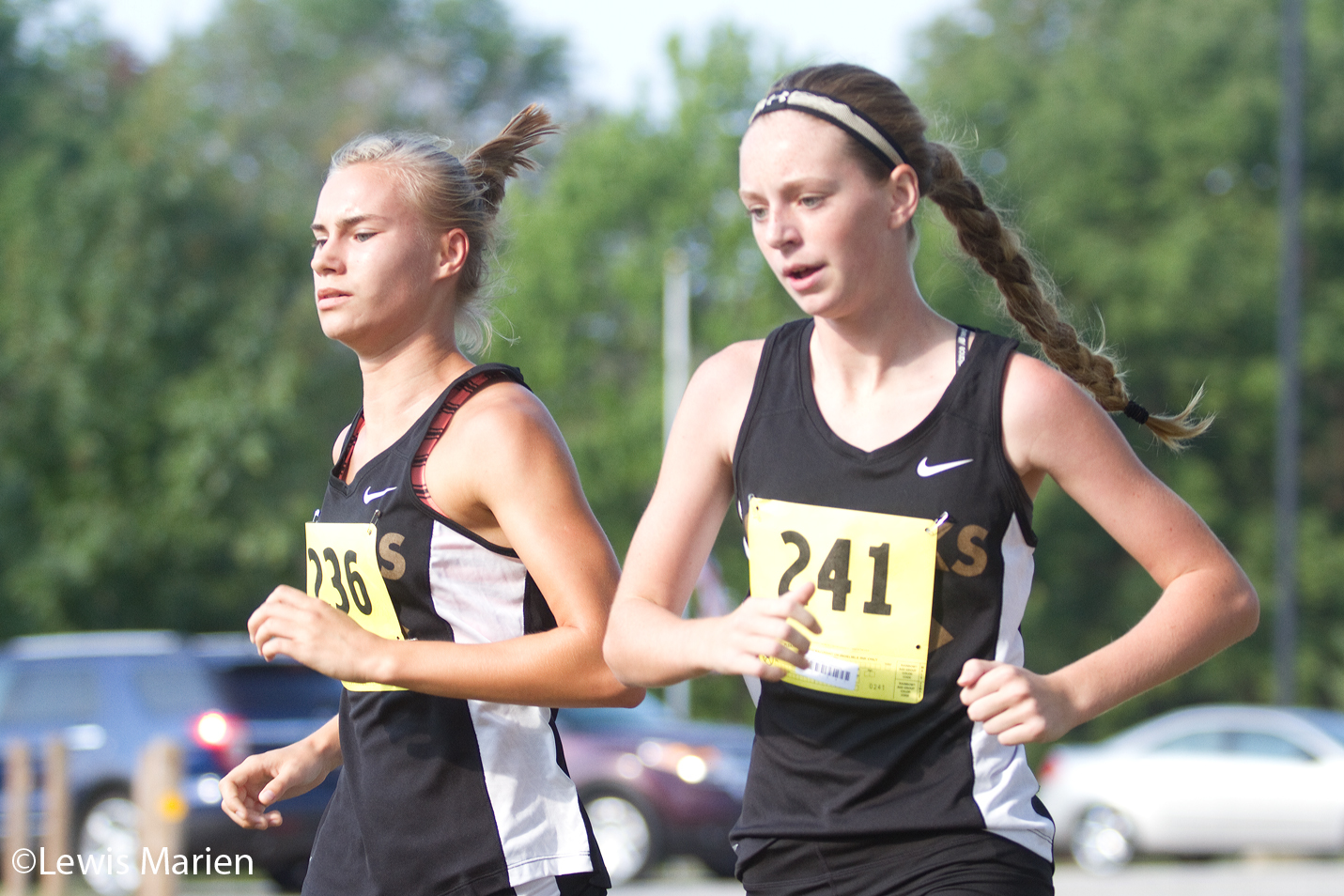 Galesburg's Anastasia Beetler, left, and Kaitlyn Pendergast compete in the varsity girls race on Sept. 5 during the Silver Streaks Invite at Lake Storey in Galesburg, Ill. Pendergast took fifth place in the race and the girls team finished in sixth overall.