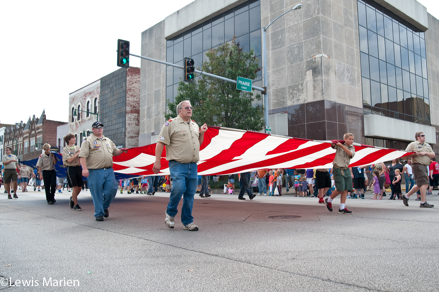 Local Boy Scouts of America members carry a large U.S. flag down East Main Street in Galesburg, Ill.,during the 123rd annual Labor Day Parade on Sept. 7. Galesburg's parade is the second oldest in the nation.
