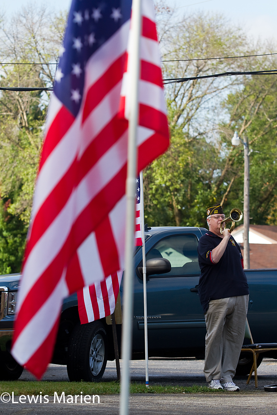 """Galesburg VFW Post 2257 Quartermaster Dan Jacobs plays """"Taps"""" during the post's annual remembrance of the 9/11 attacks on Sept. 11. The ceremony included a reading of names of local men that died in the War on Terror, a 21 gun salute and the display of a U.S. flag that flew over Afghanistan."""
