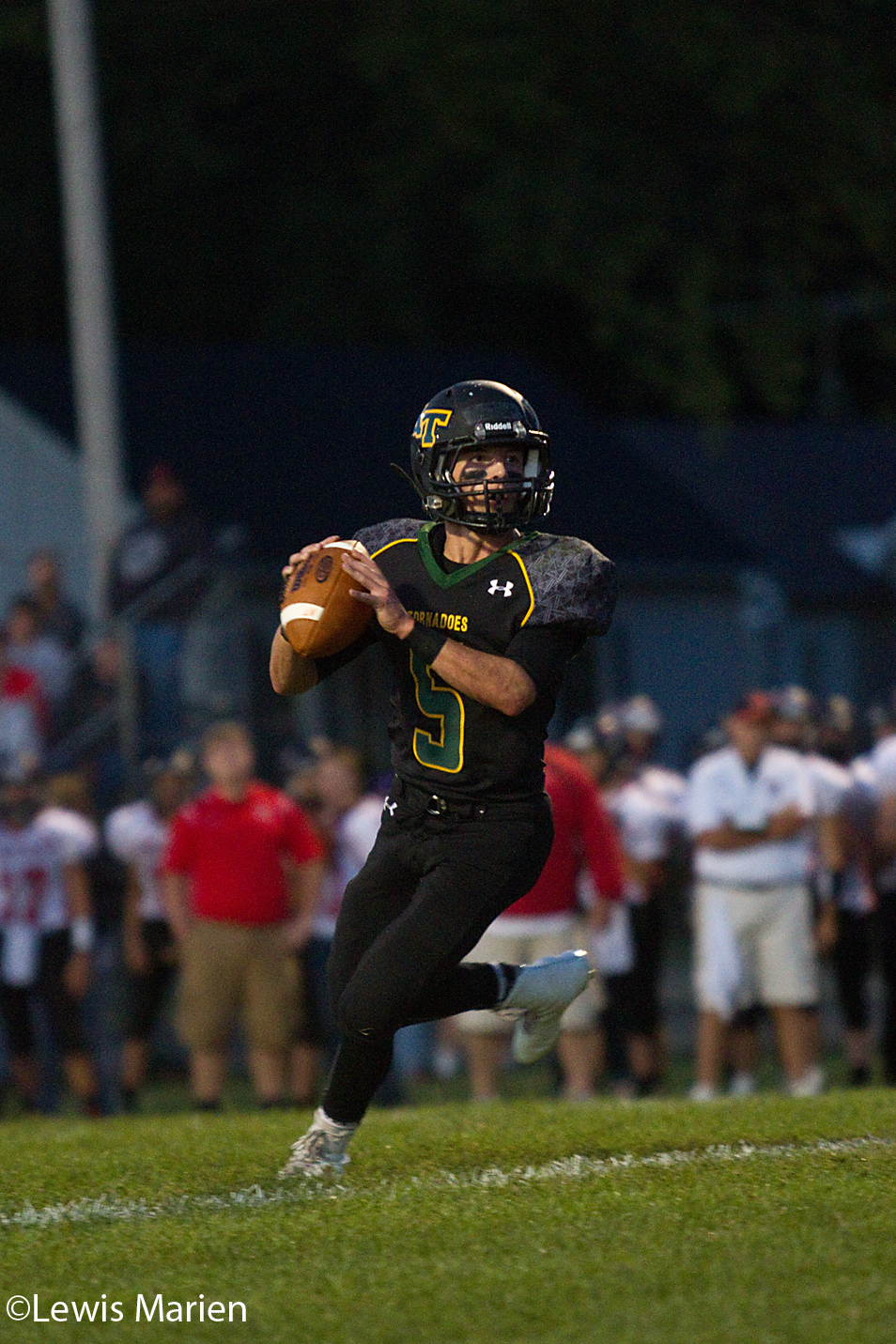 Abingdon-Avon quarterback Bo Glaser looks for an open teammate during the Tornadoes' game against North Fulton on Sept. 11 in Abingdon, Ill. The Tornadoes won 38-20.