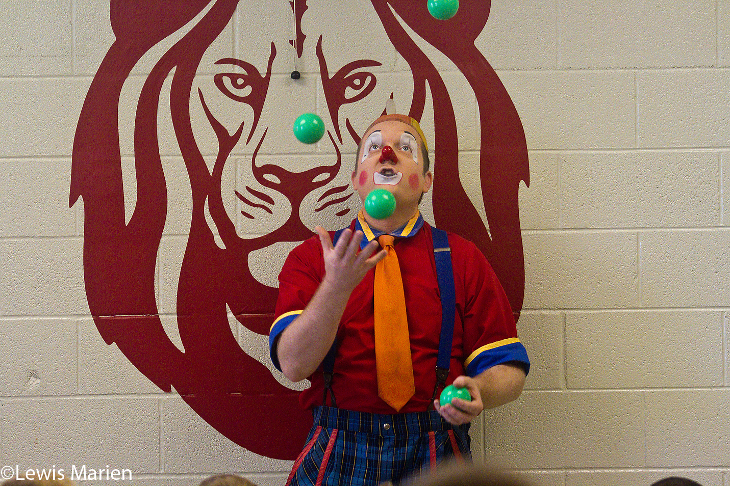 "Aaron Rider, of Hugo, Okla., also known as ""Melvino the Clown"" in the Kelly Miller Circus, performs a juggling trick for children at Galesburg Christian School on Sept. 17. The performance addressed the importance of education and as a way to bring awareness that Calvary Assembly of God in Galesburg will be hosting the Kelly Miller Circus in October."