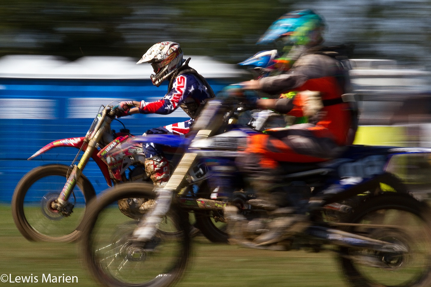 Lukas Villarreal, left, of Henderson, Ill., overtakes two other racers during the AMA District 17 Illinois State Motocross Championship on Sept. 20 at the Galesburg Motorcycle Club near Rio, Ill.
