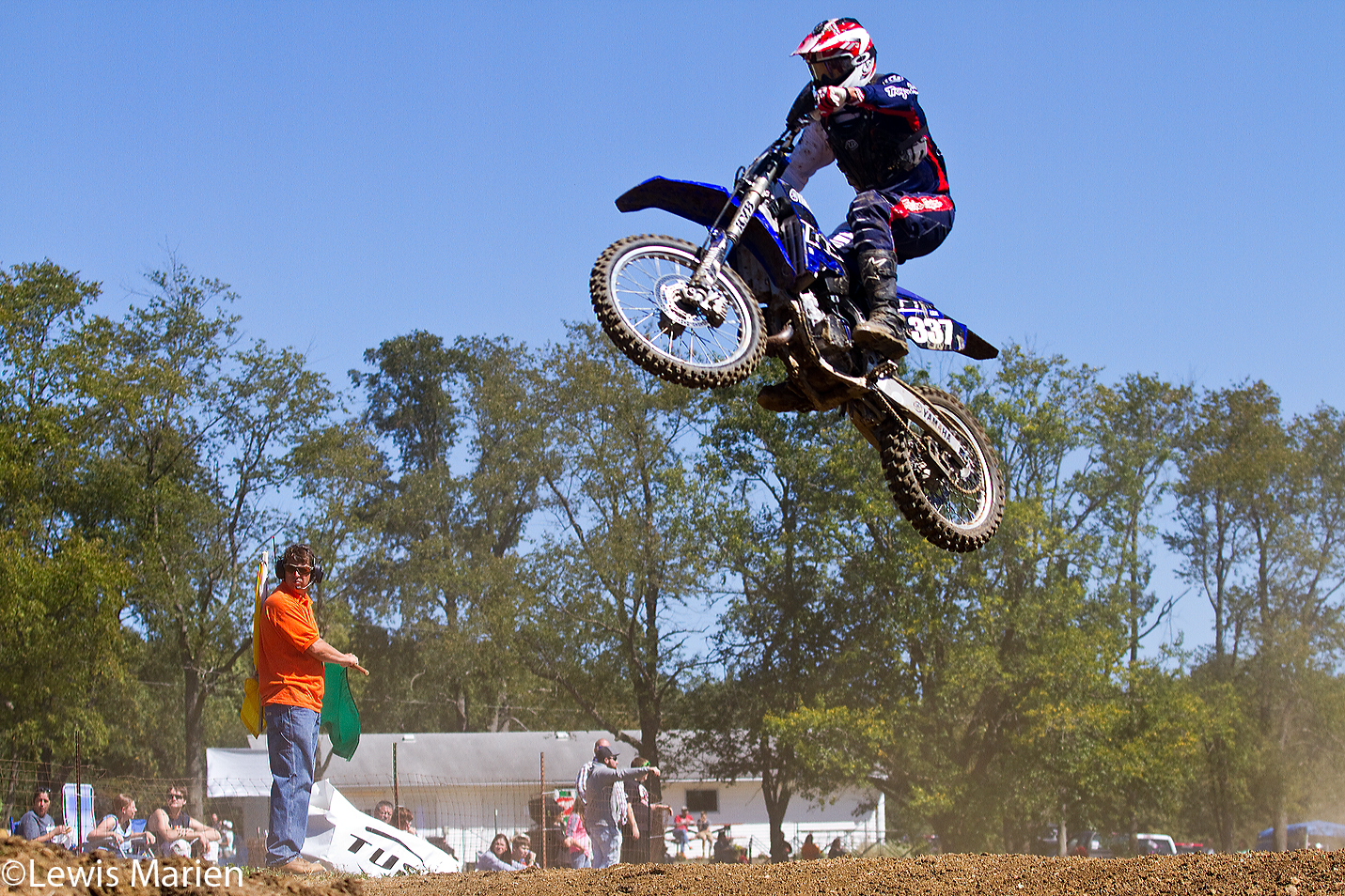 Craig Lee, of Ottawa, Ill., goes airborne during the AMA District 17 Illinois State Motocross Championship on Sept. 20 at the Galesburg Motorcycle Club near Rio, Ill.