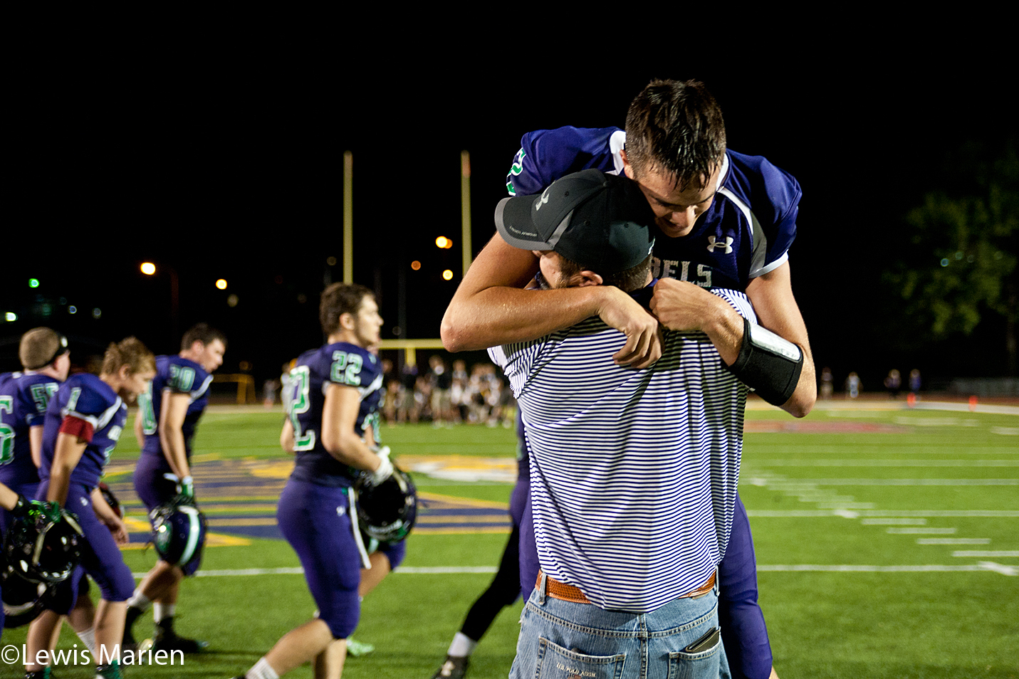 South Fulton's Trace Hood leaps into his father's arms after the Rebels defeated the Abingdon-Avon Tornadoes 32-26 on Sept. 25 at Western Illinois University's Hanson Field in Macomb, Ill.