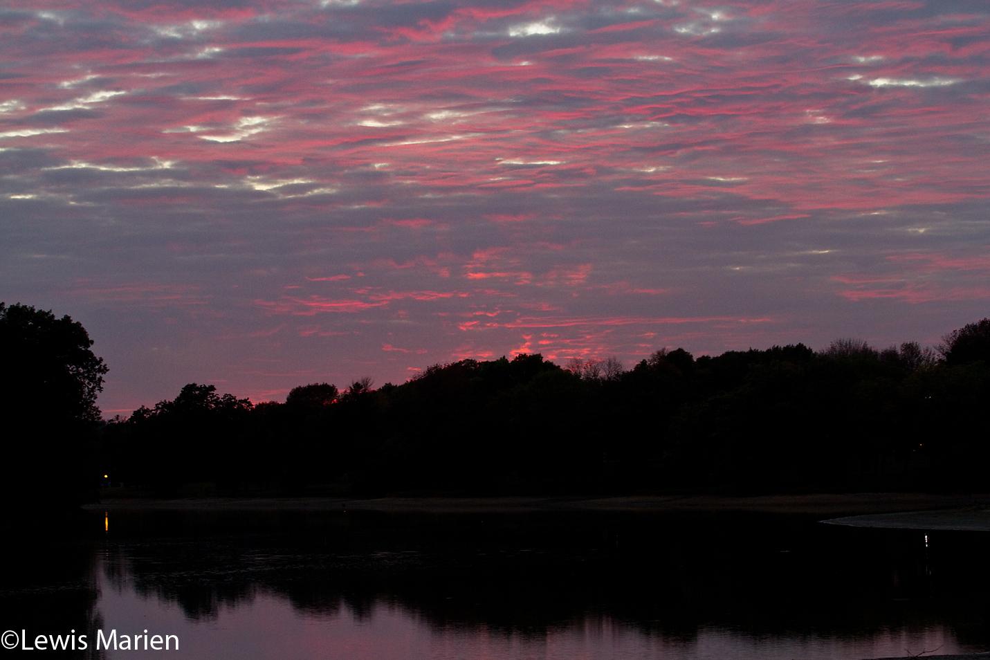 A pink sky illuminates Lake Storey in Galesburg, Ill., on Oct. 6.