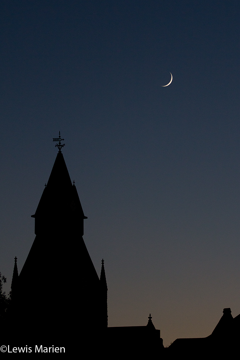 A crescent moon is seen over the Knox County Courthouse's clocktower in Galesburg, Ill.,on Oct. 15.