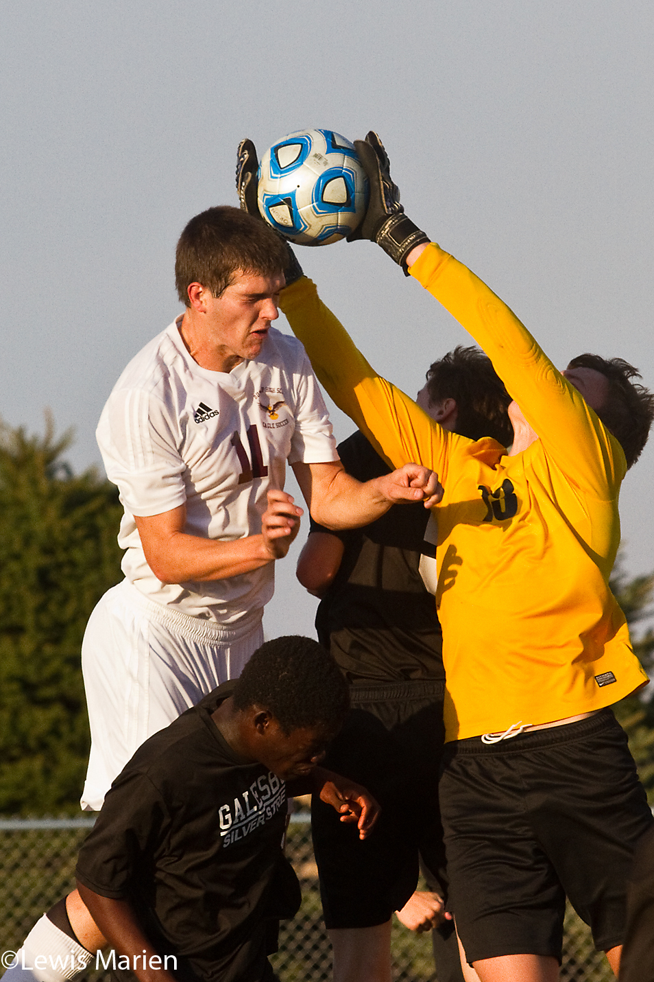Galesburg goalkeeper Jonathan Whittle, right, blocks a header from Dunlap's Clint Koehler during a Class 2A regional semifinal match on Oct. 21 at Charger Field in Orion, Ill. The Streaks lost to the Eagles 7-0.