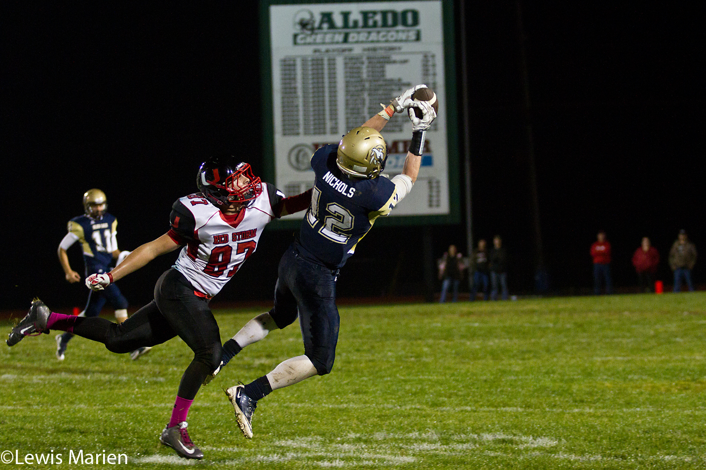 Mercer County's Ben Nichols (12) makes a leaping catch over a United's Derek Hart (87)during a game Oct. 23 at George Pratt Memorial Field in Aledo, Ill. The Golden Eagles beat the Red Storm 27-0.