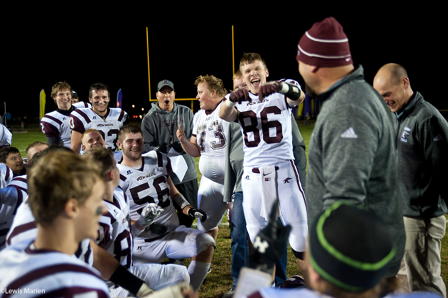 Rockridge's Drake Schroeder (86) has a little fun during his team's huddle after they beat Rushville-Industry 42-21 in the first round of the IHSA Class 2A playoffs Oct. 30 at Bob Wixom Field in Rushville, Ill.