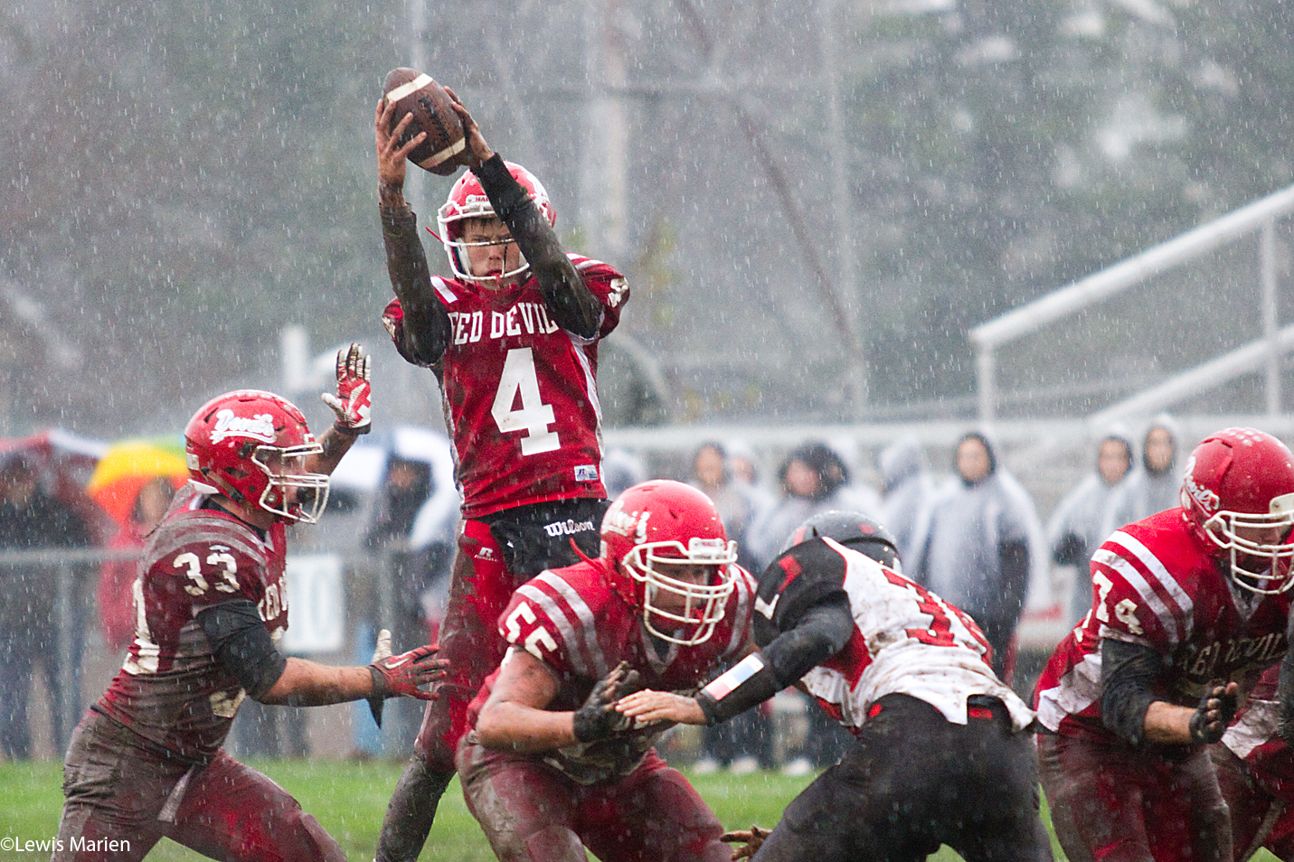 Spring Valley Hall's Drew Pullam (4) hikes the ball during the Red Devils' IHSA Class 2A first round playoff game with the United Red Storm on Oct. 31 at Richard Nesti Stadium in Spring Valley, Ill. The Red Devils beat the Red Storm 34-0.