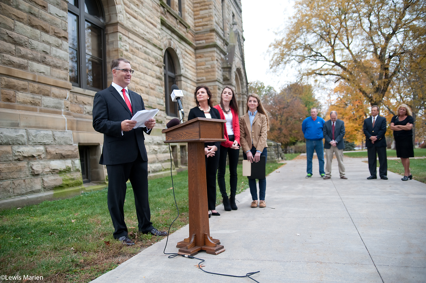 Mike DeSutter, left, of Woodhull, Ill., announces that he will seek the Republican nomination for state representative of the 74th District on Nov. 5 outside the Knox County Courthouse in Galesburg, Ill.