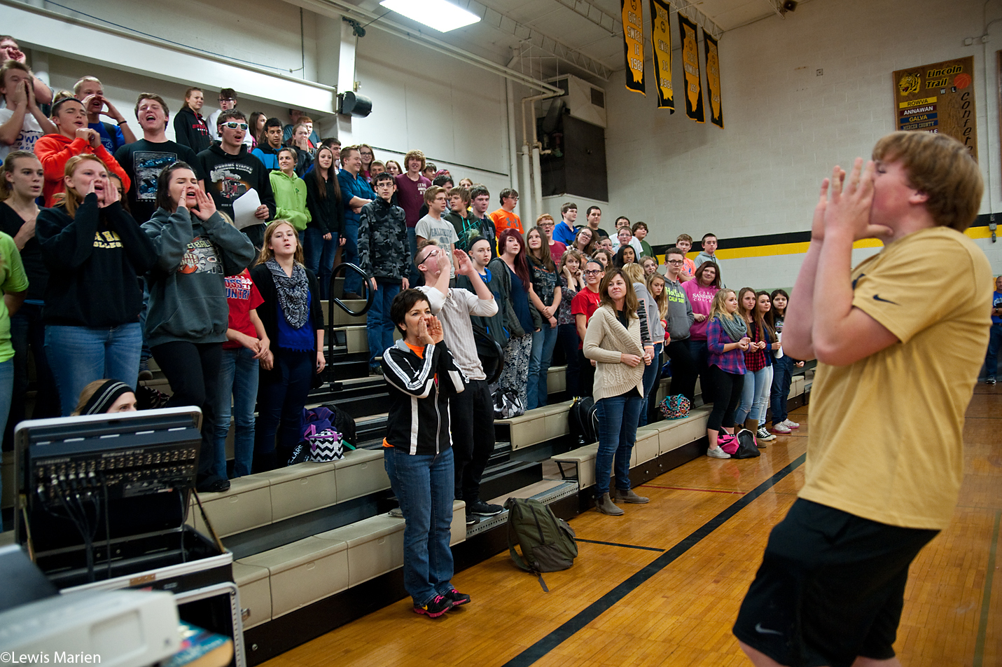 """ROWVA High School sophomore Charlie Gibbons, right, leads a group of students in the chant """"2n2 is what we do"""" during a pep rally Nov. 6 in the school's gymnasium. The school located in Oneida, Ill., has been named a finalist out of 50 schools nationwide for the """"Celebrate My Drive"""" competition sponsored by State Farm, with one school receiving an Echosmith concert and 10 other schools each receiving $100,000 grants."""