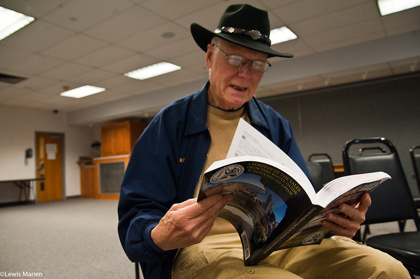"""K.C. Hill,of Galesburg, Ill.,looks through a copy of """"Outside the Rails: A Rail Route Guide from Chicago to La Plata, Mo.,"""" Nov. 7 at the Galesburg Public Library. The book, by authors Robert and Kandace Tabern of Wadsworth, Ill., explores in great detail the sights that passengers see out their train windows when passing through Illinois, Iowa, and Missouri aboard Amtrak's Southwest Chief train out of Chicago."""