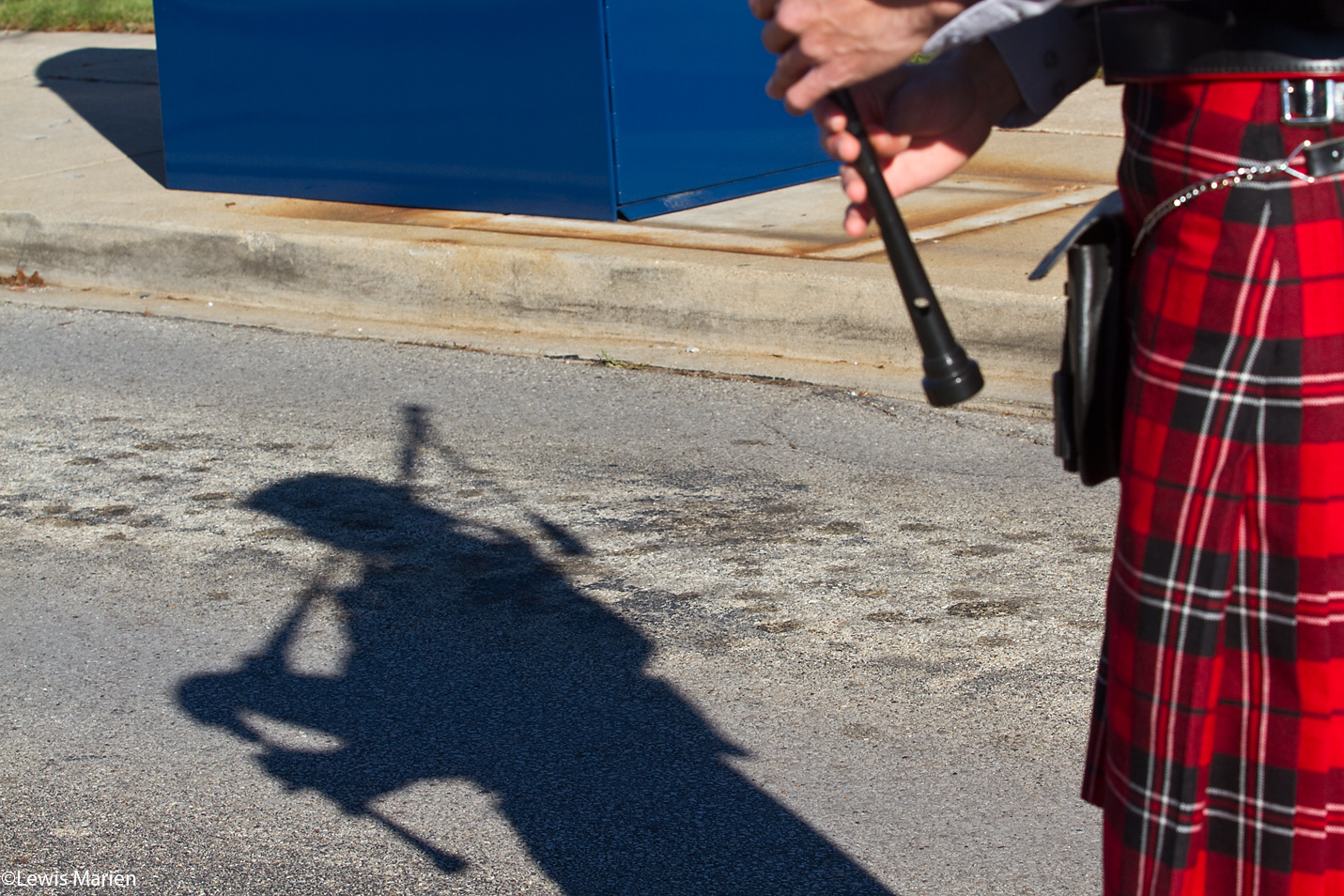 A member of the Monmouth College Pipe Band warms up prior to the start of the 15th annual Veterans Parade Nov. 8 in downtown Galesburg, Ill.
