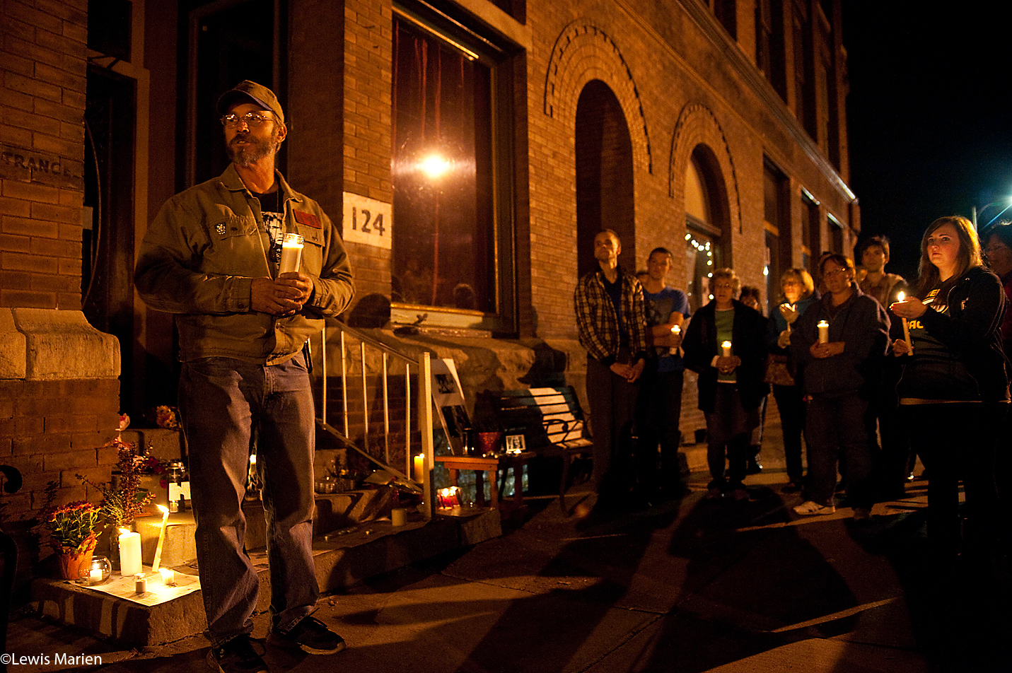 Paul Brechbuhler, left, of Galesburg, Ill., speaks to attendees of a candlelight vigil Nov. 15 outside The Beanhive in Galesburg, Ill. Members of the community attended the candlelight vigil for Sally Christianson, 18, of Wataga, Ill.,who died overnight Nov. 12 in a single-car accident.
